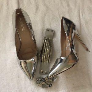 Metallic silver women's pumps.